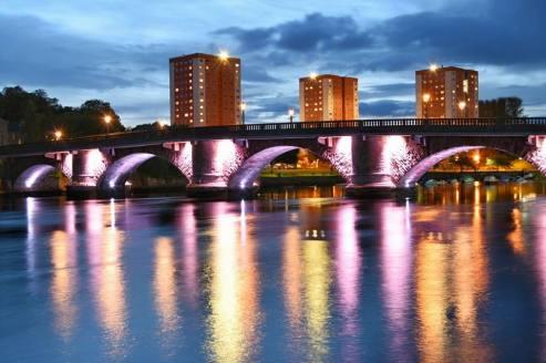 Bridge lit up at night pic by Karen Muir