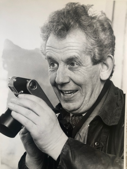 Mitchell David with camera