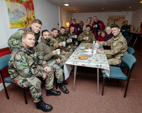 Pictured: Royal Marines and their Dutch counterparts share a cup of tea and cake with residents of Garelochhead. HMNB Clyde has donated Christmas trees to several communities around Argyll & Bute. The trees were cut from MoD land by Babcock and delivered by Santa's little helpers; members of 43 Commando Fleet Protection Group Royal Marines.