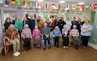 Crosslet House PIC SHOWS Cllr Marie McNair with the team and residents