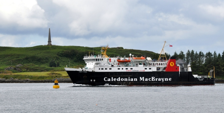 Oban 1 A Calmac ferry, Lord of the Isles, sails into Oban Bay with Kererra and the Hutcheson Memorial in the background.