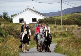 Connacht 8- horse riding's a favourite pasttime around Cleggan and Omey strand in Connemara.