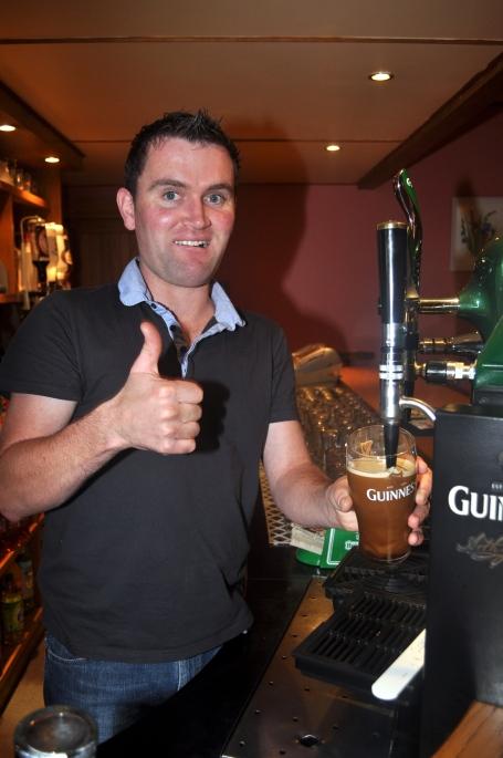 Cleggan Paul pouring a pint at the Strand Bar in Claddaghduff